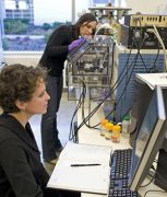 Purdue graduate students Allison Dill and Livia Eberlin use   desorption electrospray ionization, or DESI, to examine samples. They   are part of a research team led by Graham Cooks, Purdue's Henry Bohn   Hass Distinguished Professor of Chemistry, that uncovered a potential   prostate cancer marker. (Photo courtesy of Graham Cooks)