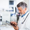 Doctor-using-tablet-iPad