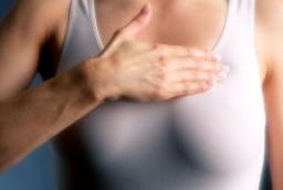 woman-examining-breasts-xl