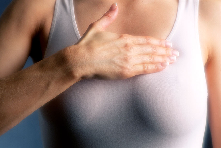 woman-examining-breasts-xl